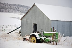 John Deere A in the Snow With Shed